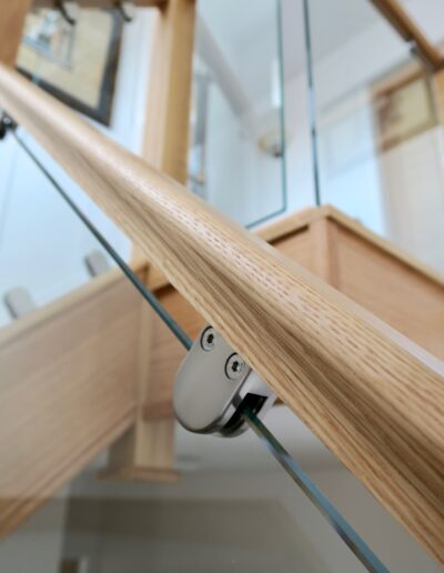 Oak handrail with Round Brushed Steel Clamps