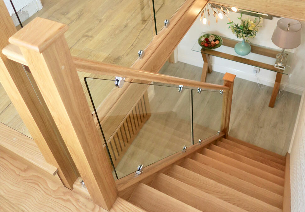 Solid oak treads with glass, staircase renovation in Cheadle, Cheshire