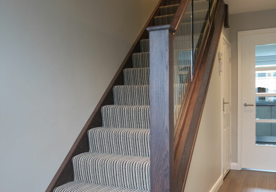 Contemporary in-line glass staircase in Cheadle Hulme, Cheshire