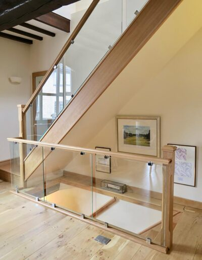 Bracket Mounted Glass with Chamfered Newel Posts in Oak