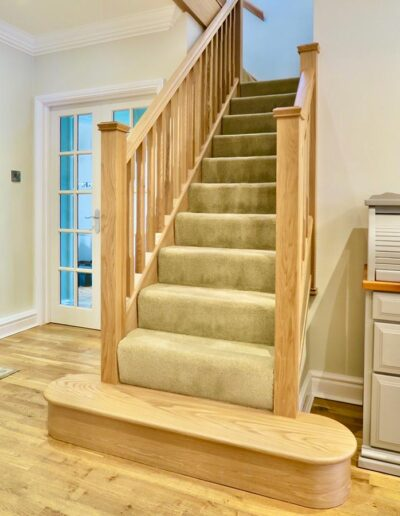 Oak Spindle Staircase Renovation with Double Curtail Step